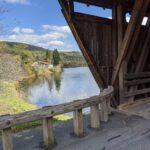 Image of covered bridge and water below